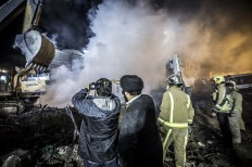 Firefighters working hard to control the fire and find the remaining of their colleagues and civilians under the debris of 17-story high-rise landmark. On 19 January 2017, the disaster struck the Plasco building, an iconic 50-year-old structure in central Tehran. 25/01/2017 - Tehran – Iran