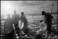SOUTH AFRICA. Cape Town. 1999. Every Sunday, at dawn, priests of the Zion Church, from the Khayelitsha black township, take their newly converted congregation to the sea to be baptised through immersion.