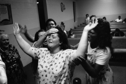 "USA. Georgia. Kingston. 1996. Church of Lord Jesus Christ (Pentecostal church). ""Holy Spirit"" taking possession of a woman, during a spirited service."