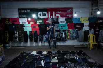 Gorgan, Iran - MAY 1: Mustafa, 26, is from Gorgan. He sells men's clothes at nights. His night sale is 80,000 tomans, almost equal to $ 6.Iran is amongst five of the countries with the highest spread of COVID-19. IranÕs government began an official lockdown on March 15th, 2020, the quarantines in place are for those who do not exhibit symptoms but have been exposed to the illness. For the large number of Iranians who live on a day by day income, staying home, means having no money to pay for essential things such as food. Therefore, they must take their life in their own hands and work in order to survive even at the risk of getting infected, spreading the virus in society at large, and even getting fined for breaking the quarantine. For them, choosing either path has extreme consequences.(Photo by Kianoush Saadati/NVP Images)
