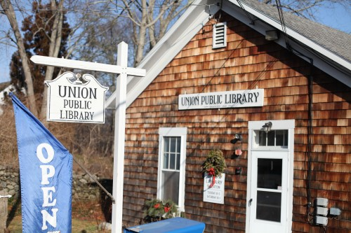 A photo of the Union Library with an open sign