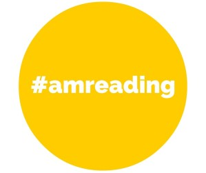 A yellow circle that says #amreading