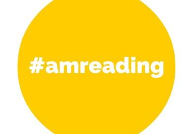 A yellow circle that says #amreading