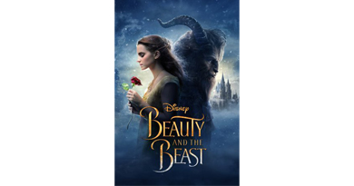 cover of the live action beauty and the beast movie picturing the beast and bell holding a rose