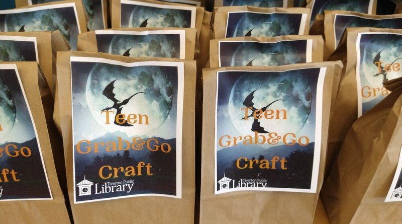 grab and go brown paper bags with a craft inside on a shelf