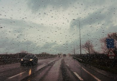 rain covered windshield cars on the road in a storm