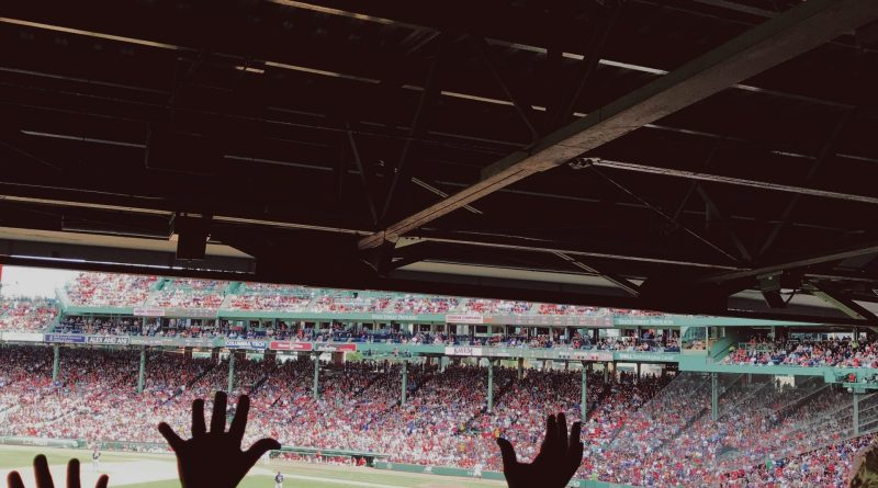 crowd arms up for the wave at fenway park boston red sox