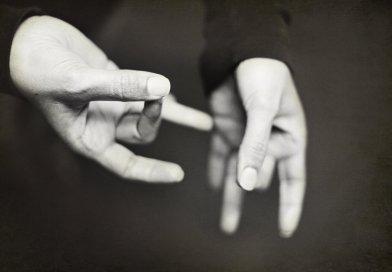 hands performing sign language gestures