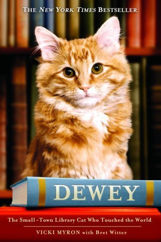 'Dewey: The Small-Town Library Cat Who Touched the World' by Vicki Myron book cover. a cat sitting on a book