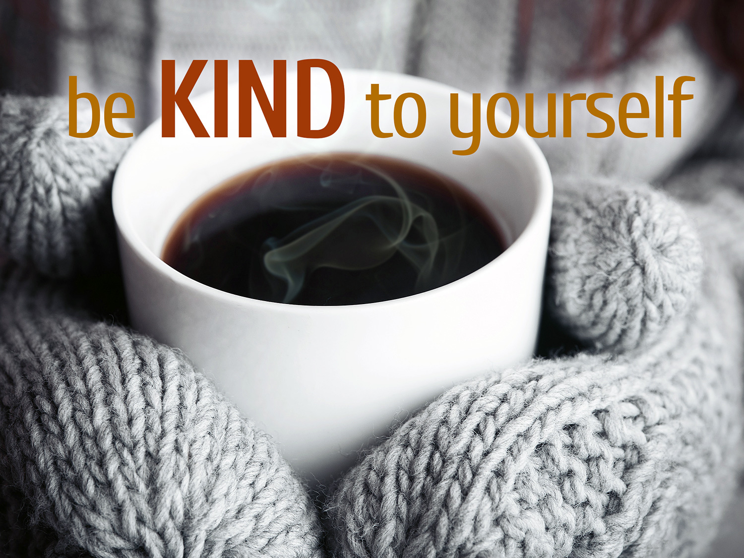 daily inspirational quote image: close up 2 hands, wearing gray knitted mittens holding a smoking hot coffee mug