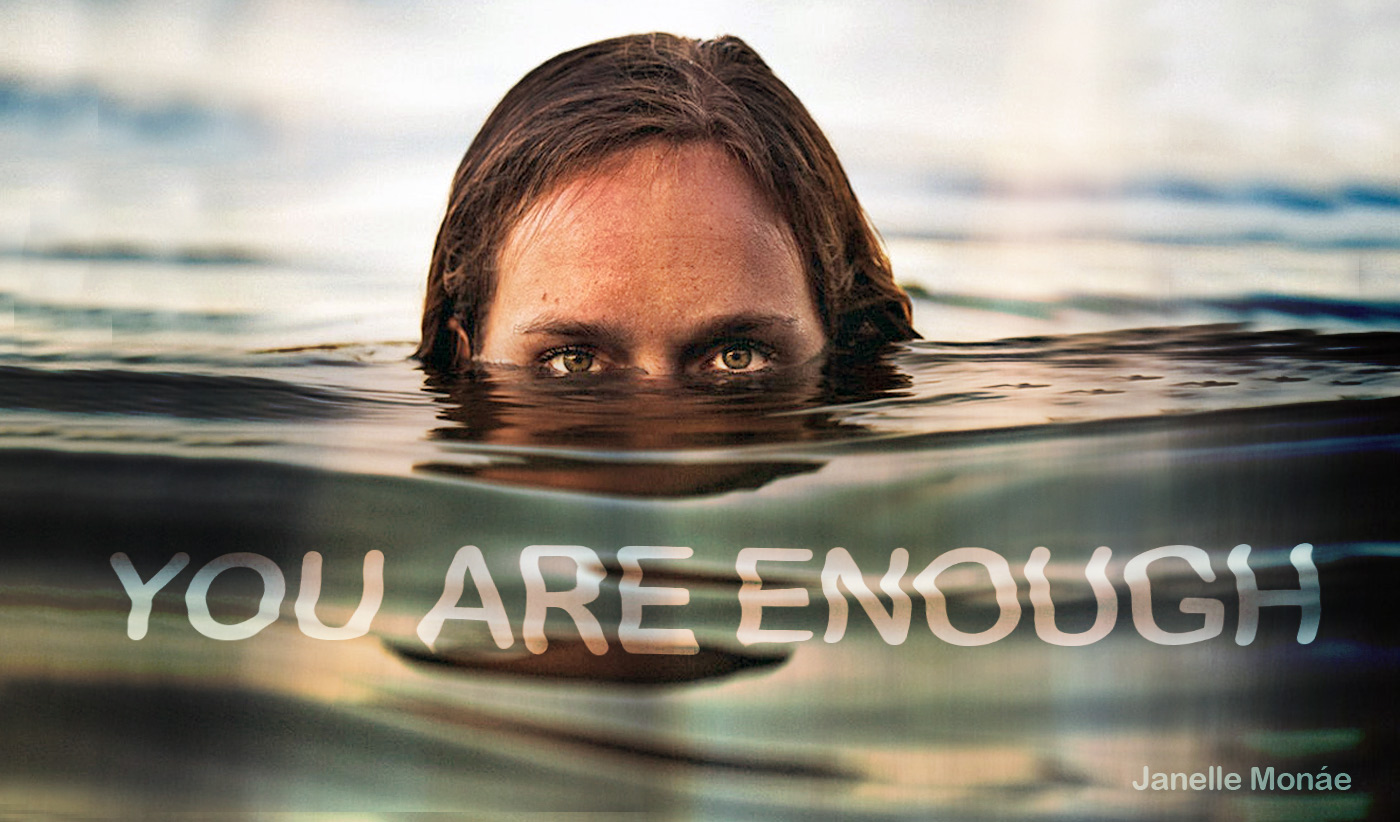 daily inspirational quote image: woman emerging from the water, with only eyes visible