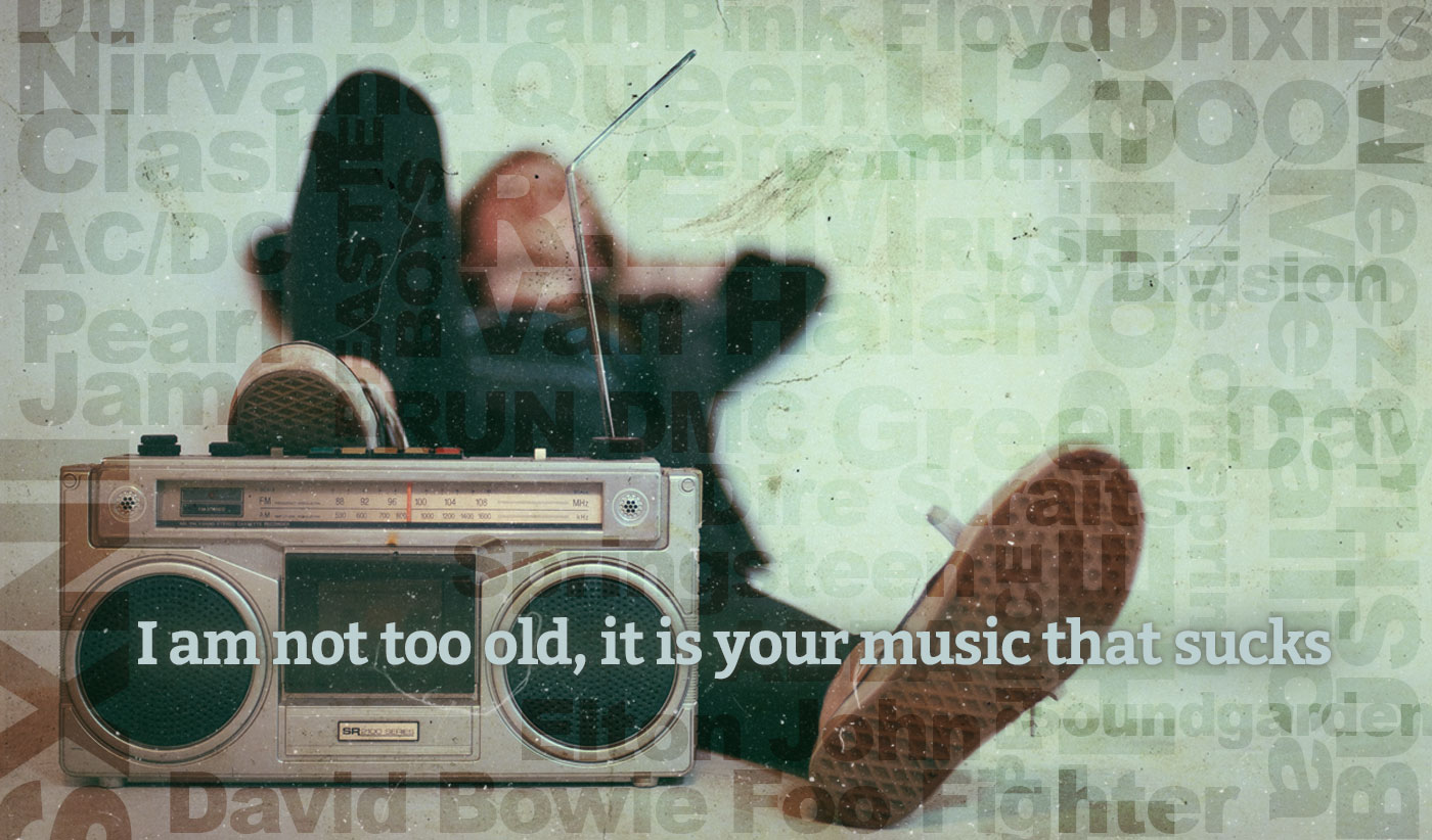 daily inspirational quote image: a boombox in the foreground while a person wearing Converse sneakers is lying down behind it