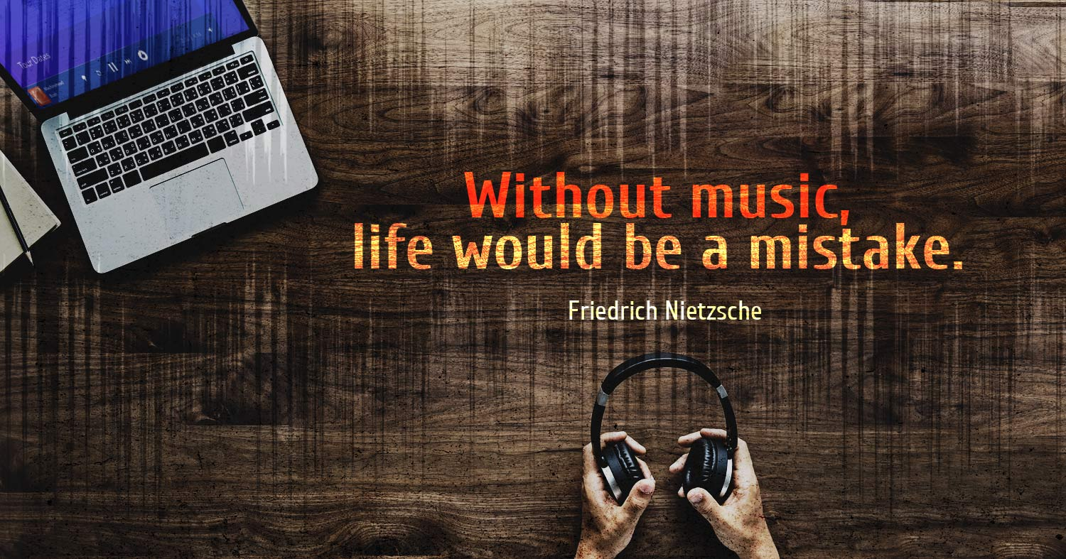 daily inspirational quote image: a laptop and hands holding headphones on a wooden table, seen from above