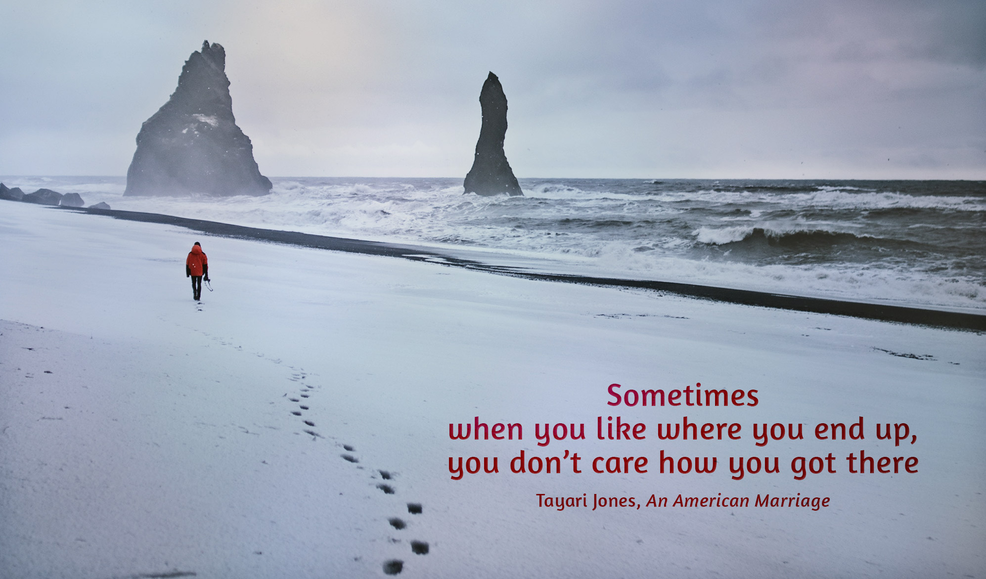 daily inspirational quote image: an Icelandic beach with a man walking in the distance