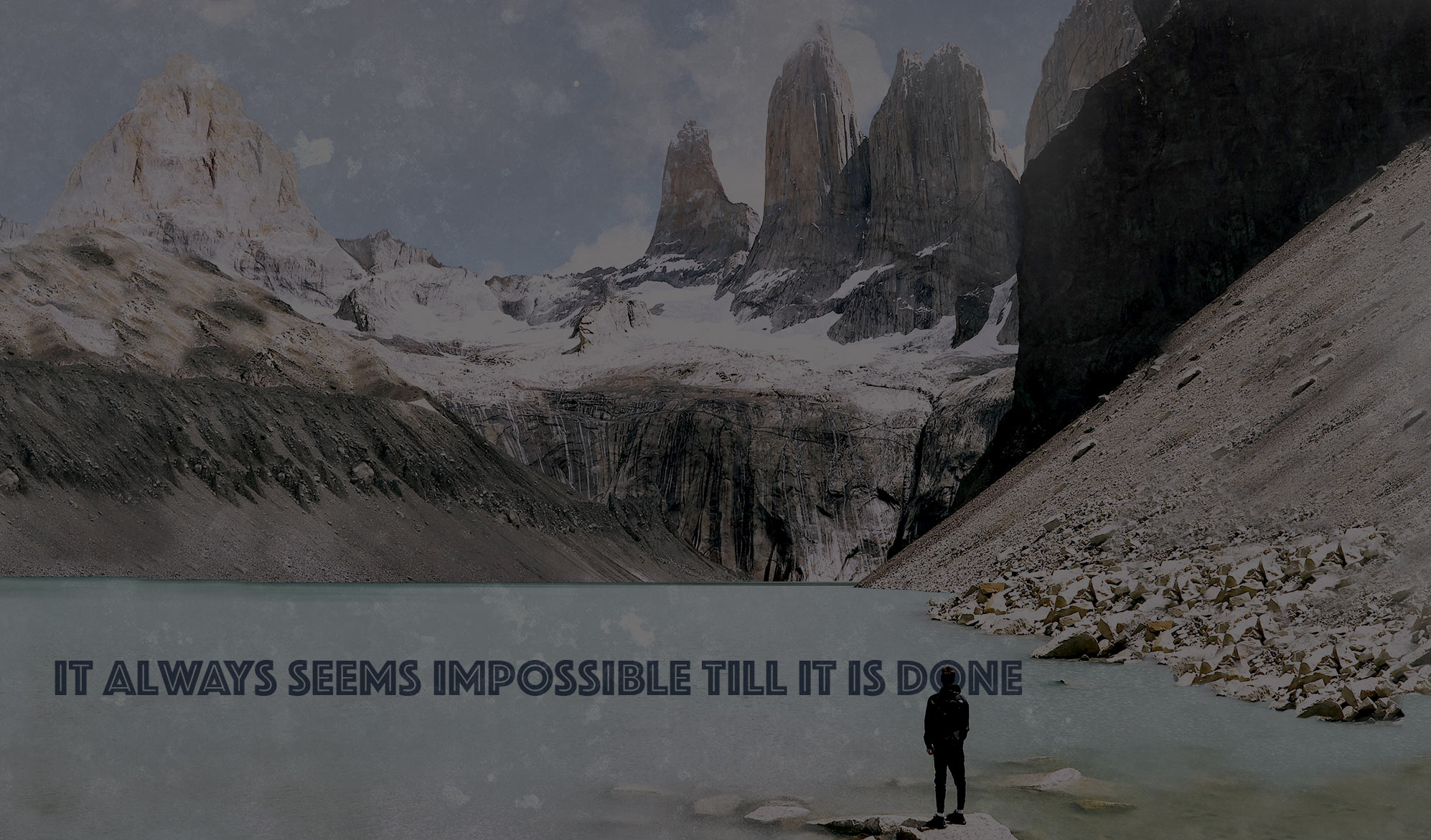 daily inspirational quote image: a man looking at a lake and very tall mountains