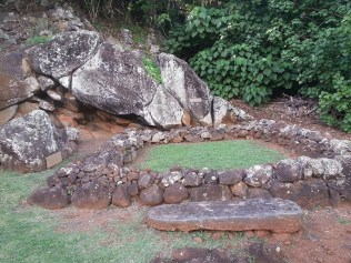 Heiau (temple), birthstones (at left) to support mother as she gave birth to a royal. Square outline of stones notes place of shack where she stayed prior to the birth.