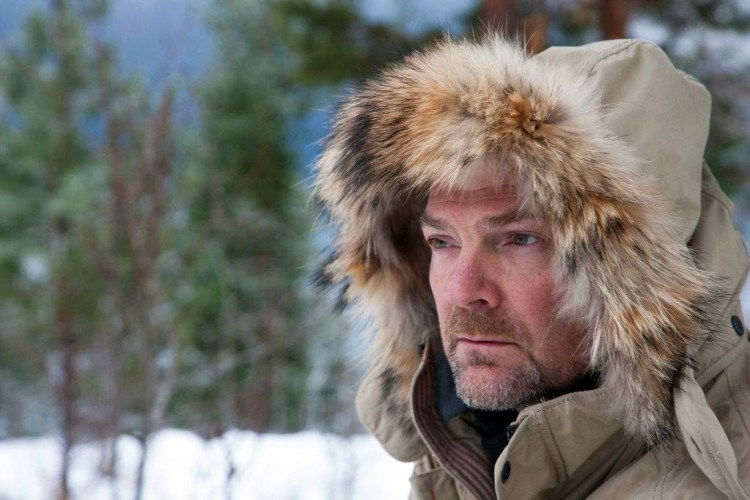 Survivorman in a winter landscape.