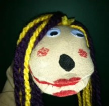 Leslie Birch said we need a mascot and it should be a sock puppet! Joy The Sock Puppet