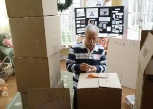 Bob Breeser packages socks for the homeless for The Joy of Sox