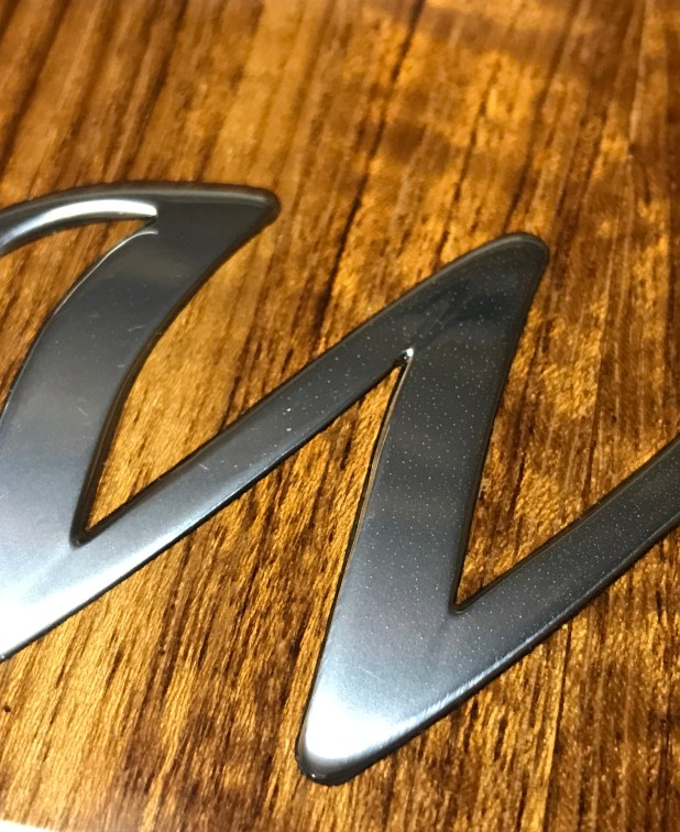 "1/8"" laser cut Stainless steel inlay set in exotic teakwood table."