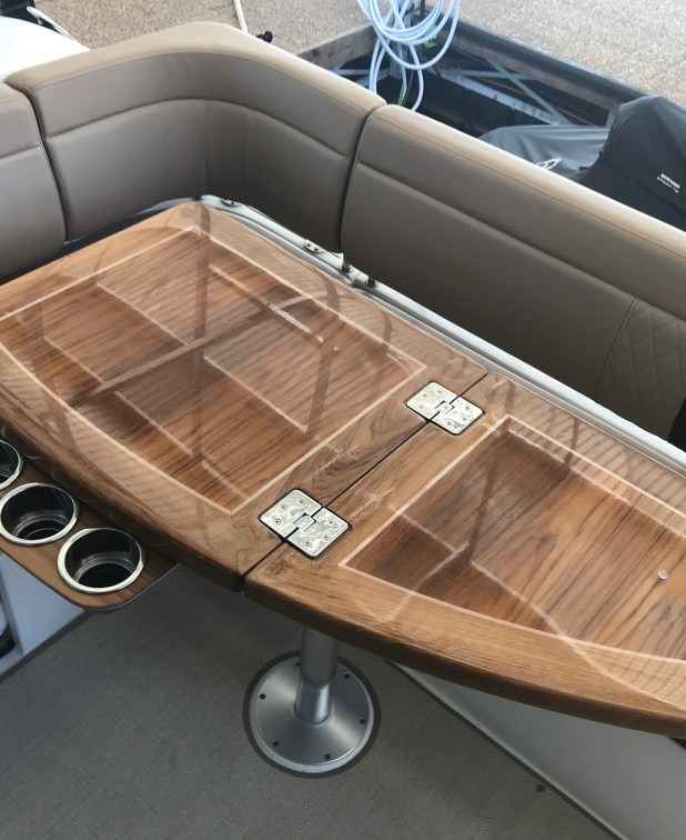 Aft cockpit table features sliding cup holder tray