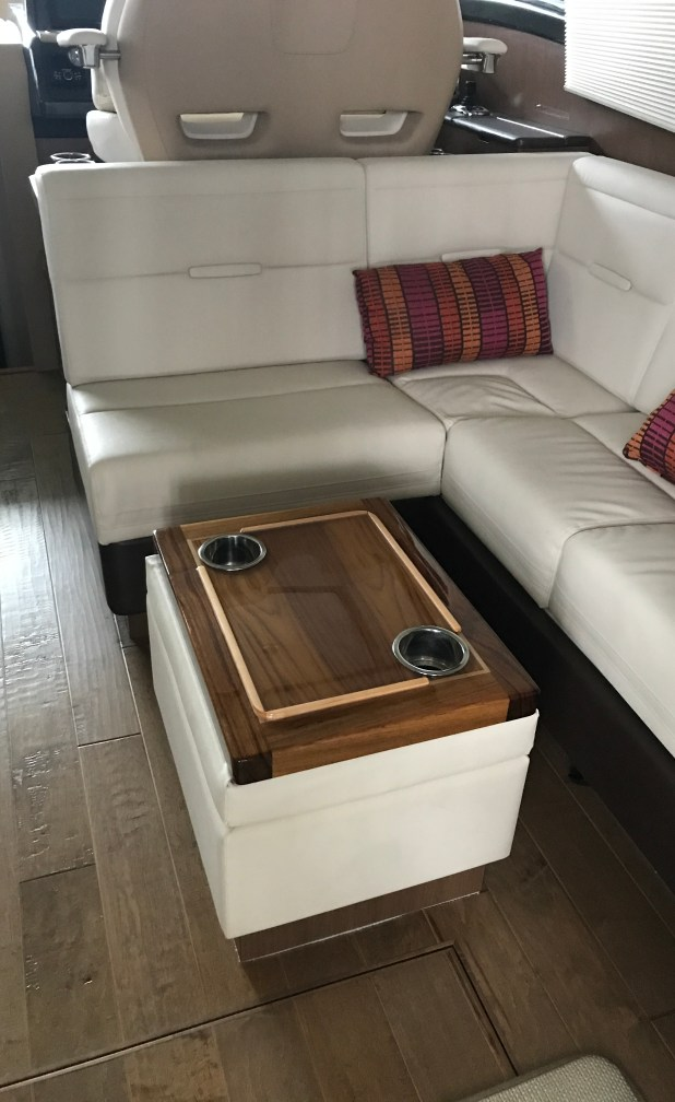 Turning the ottoman cushion over reveals two additional cup holders