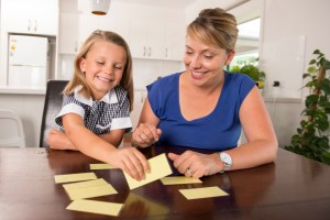 mom and daughter practicing speech with flash cards