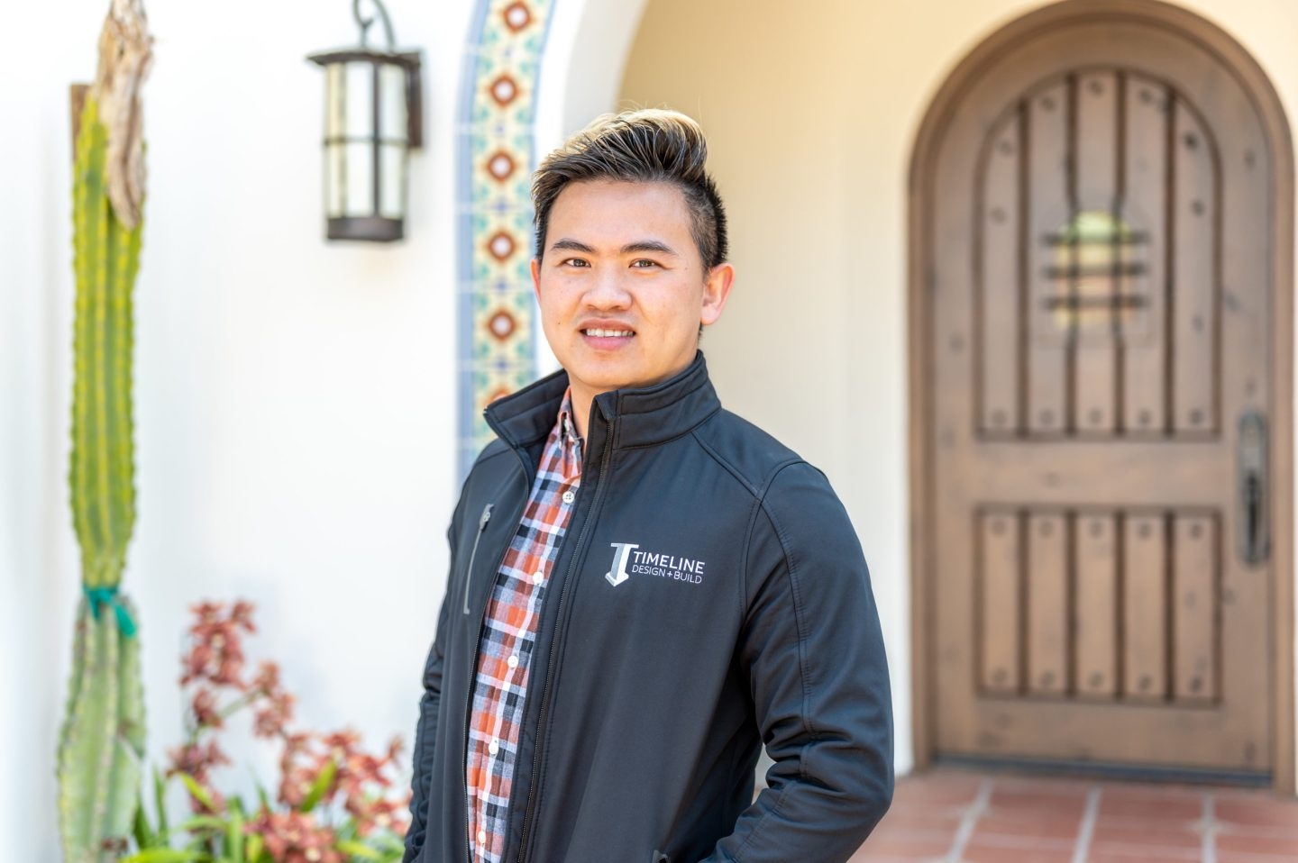 Kyle Le featured in front of a Timeline custom home.
