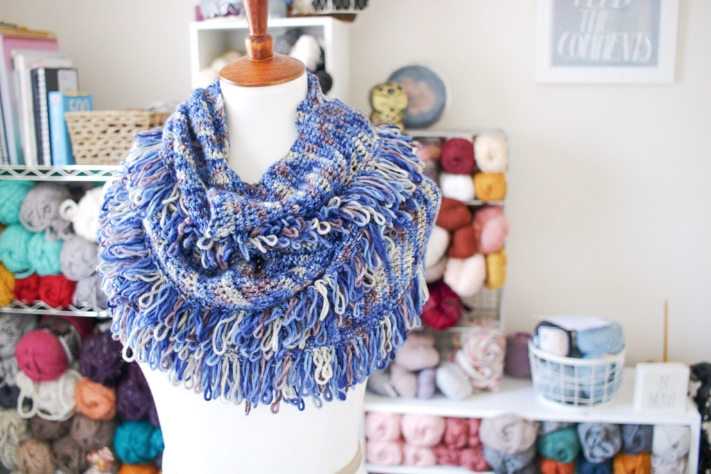 Try the Cara Scarf, a FREE crochet fringe wrap pattern from TL Yarn Crafts. Learn the fun and funky loop stitch and make this beautiful cowl from your favorite worsted weight wool. Find the pattern now on TLYCBlog.com.