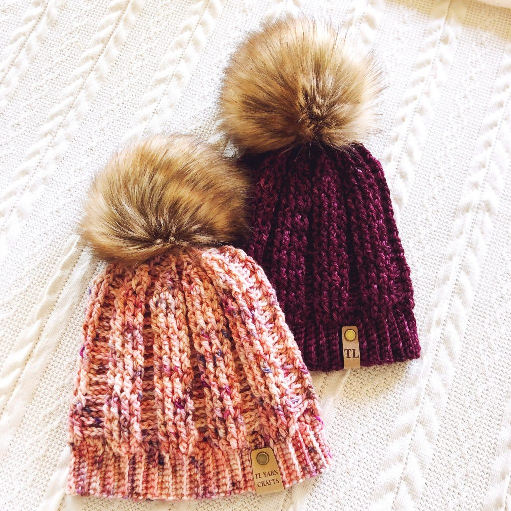 Make the new Barclay Beanie, a fitted ribbed crochet hat with faux fur pom pom and leatherette tag. Find the pattern on LoveCrafts.com and TLYarnCrafts.com. |TLYCBlog.com