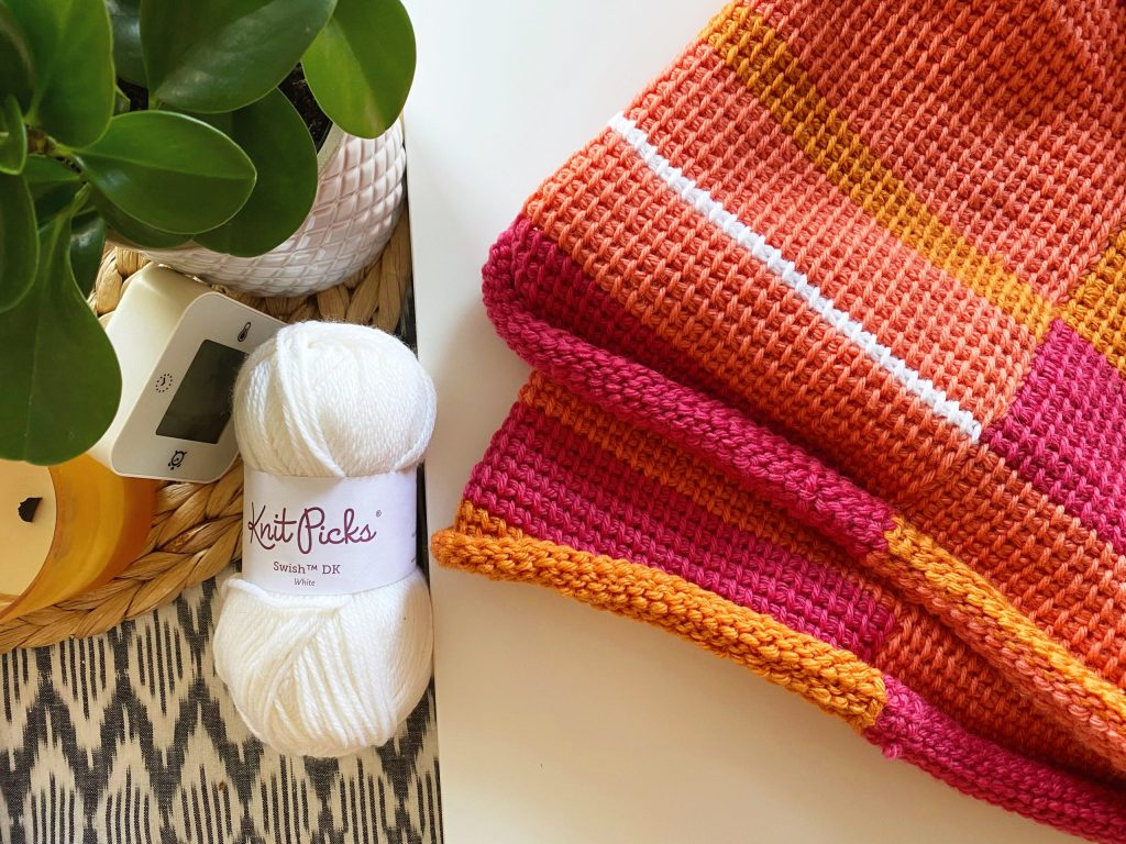 Try your hand at a Tunisian crochet temperature blanket. This FREE crochet pattern covers all the yarn used, helpful techniques, and my best advice to complete a crochet temperature blanket. Video tutorials included. | TLYCBlog.com #temperatureblanket #crochetblanket #tunisiancrochet