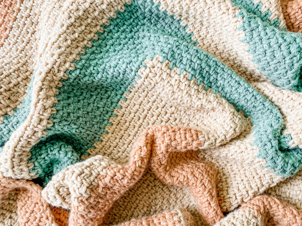 Crochet the Bradley Afghan, a free crochet pattern for a chunky modern geometric throw blanket. Includes free pattern and tutorial video. | TLYCBlog.com