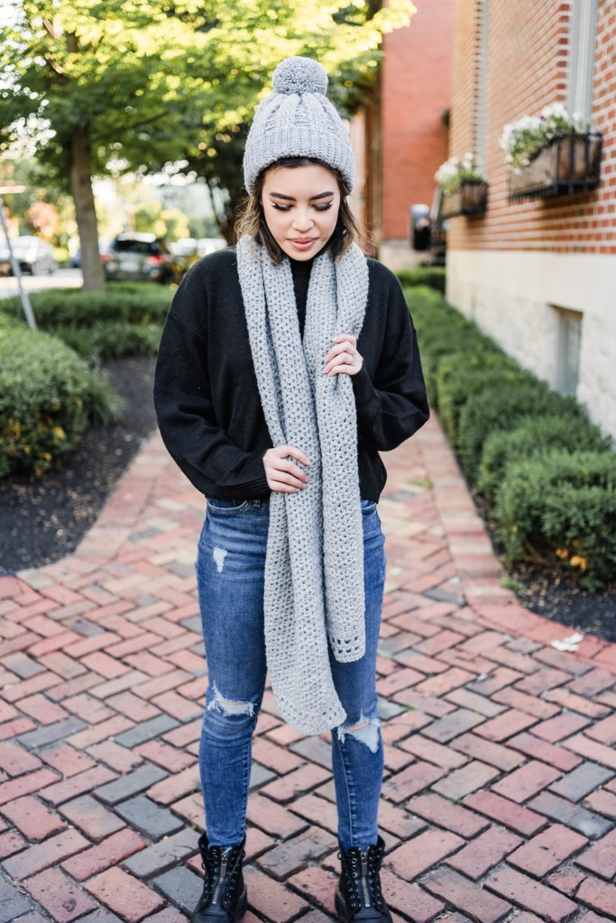 Learn to crochet this easy beginner crochet hat and scarf set with the help of a free pattern. Chic crochet pom pom hat and oversized wrap scarf.