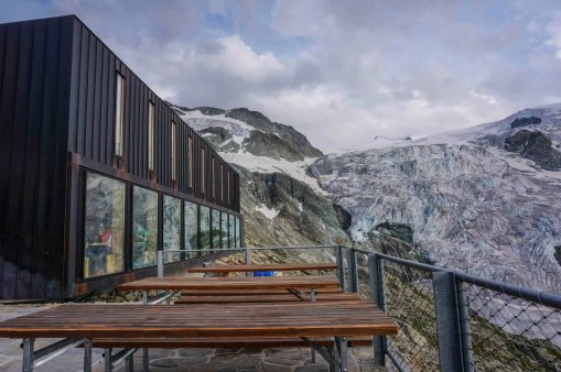 The terrace and modern dining room at Cabane de Moiry.