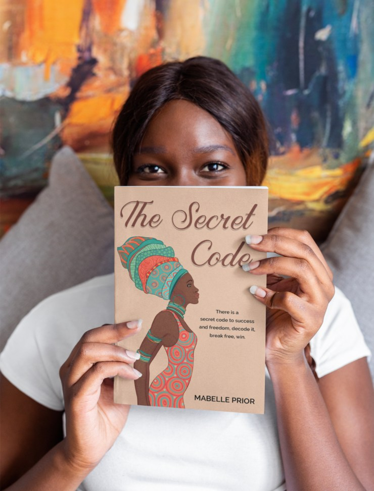A young lady showcases The Secret Code by Mabelle Prior