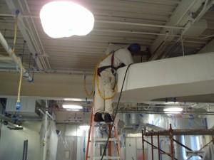 TMI preparing ceiling for coating.