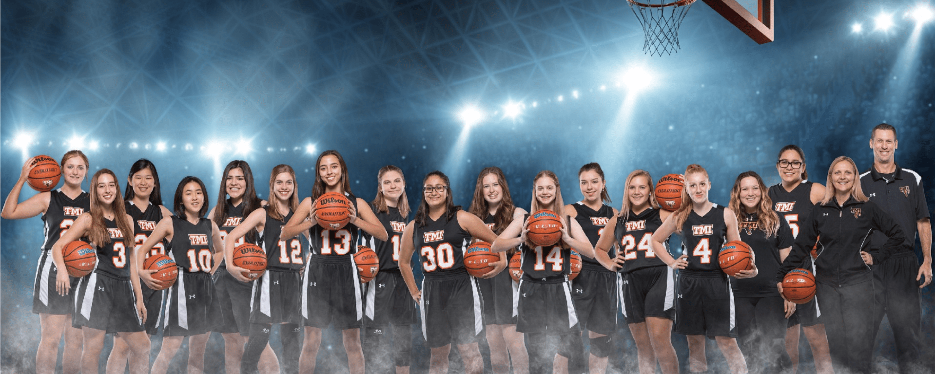 Team photo of the TMI Episcopal Varsity Girls Basketball Team