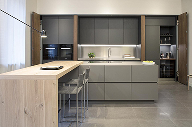 A RETRACTABLE KITCHEN WITH STAINLESS STEEL CONCEALED WORKTOP