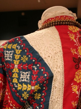 Townswoman's Holiday Dress (Back), late 19th-early 20th century. Sarafan and Linen Shirt, Central Russia; Shawl, Pavlovo-Posad, Moscow region, Russia. Private Collection of Susan Johnson. Embroidered cotton, cotton lace, silk shawl.