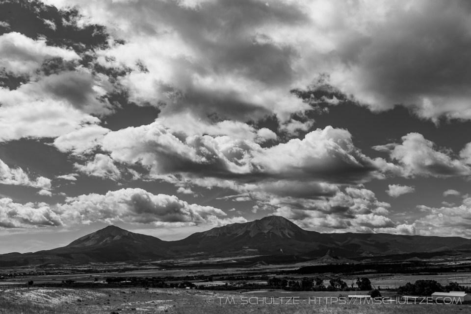 Spanish Peaks From La Veta Overlook by T.M. Schultze