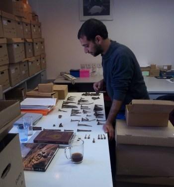 Gal Zagdon sorting ancient iron nail at hte lab