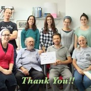 """""""Thank You!"""" with group photo of the staff at the lab in the background"""