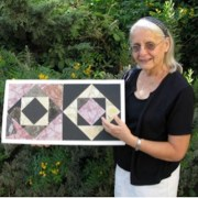 Frankie holding her reassembled Opus Sectile