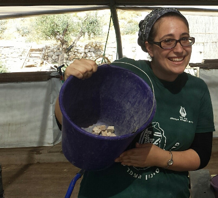 Jennifer with mosaic stones in a bucket