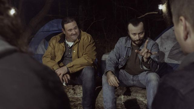 Vinny Blade (Billy Blair) and Drew (Jason P. Kendall) chat with other partygoers around the campfire at <i>Cherokee Creek</i>