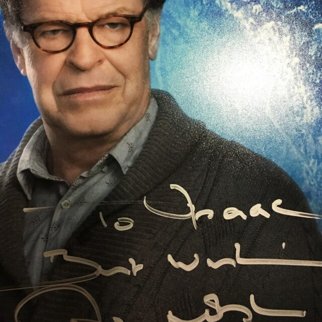 John Noble autographs a print for Isaac.