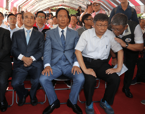Wang (L), Gou (C) and Ko (R) seated together at 823 memorial event in Taipei, Aug. 23