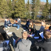High school English lesson outdoors and with guitar