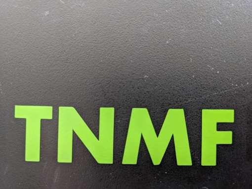 T N M F lime green decals on black mud flap