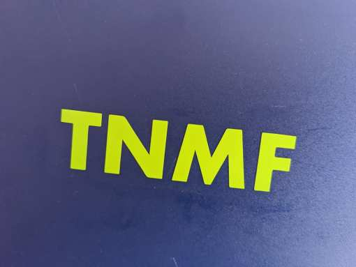 T N M F lime green decals on blue mud flap